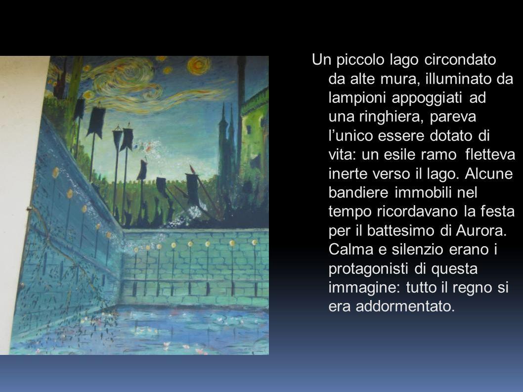 Un piccolo lago circondato da alte mura, illuminato da lampioni appoggiati ad una ringhiera, pareva l'unico essere dotato di vita: un esile ramo fletteva inerte verso il lago.