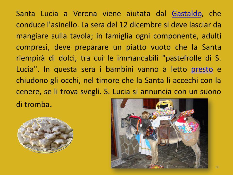 Santa Lucia a Verona viene aiutata dal Gastaldo, che conduce l asinello.