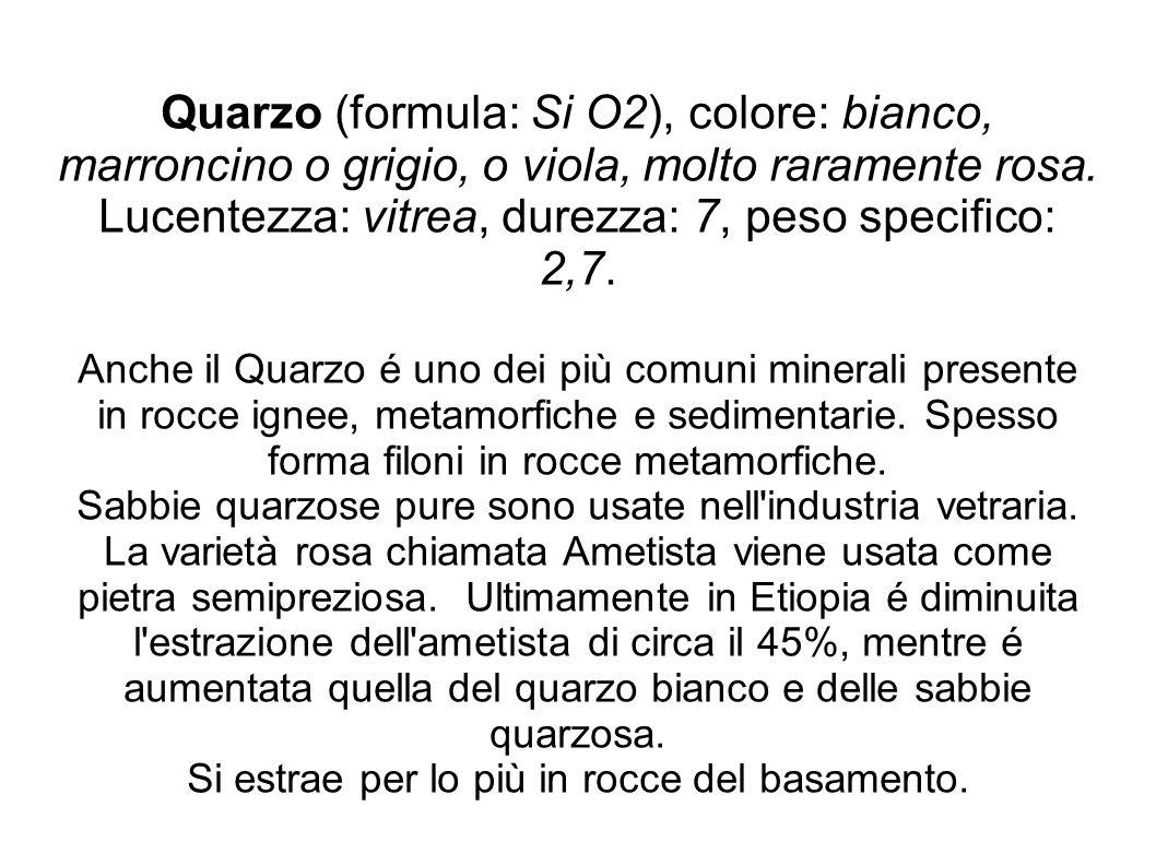 Quarzo (formula: Si O2), colore: bianco, marroncino o grigio, o viola, molto raramente rosa.