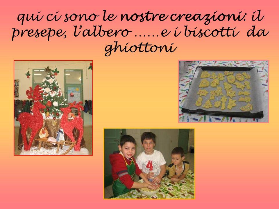 qui ci sono le nostre creazioni: il presepe, l'albero ……e i biscotti da ghiottoni