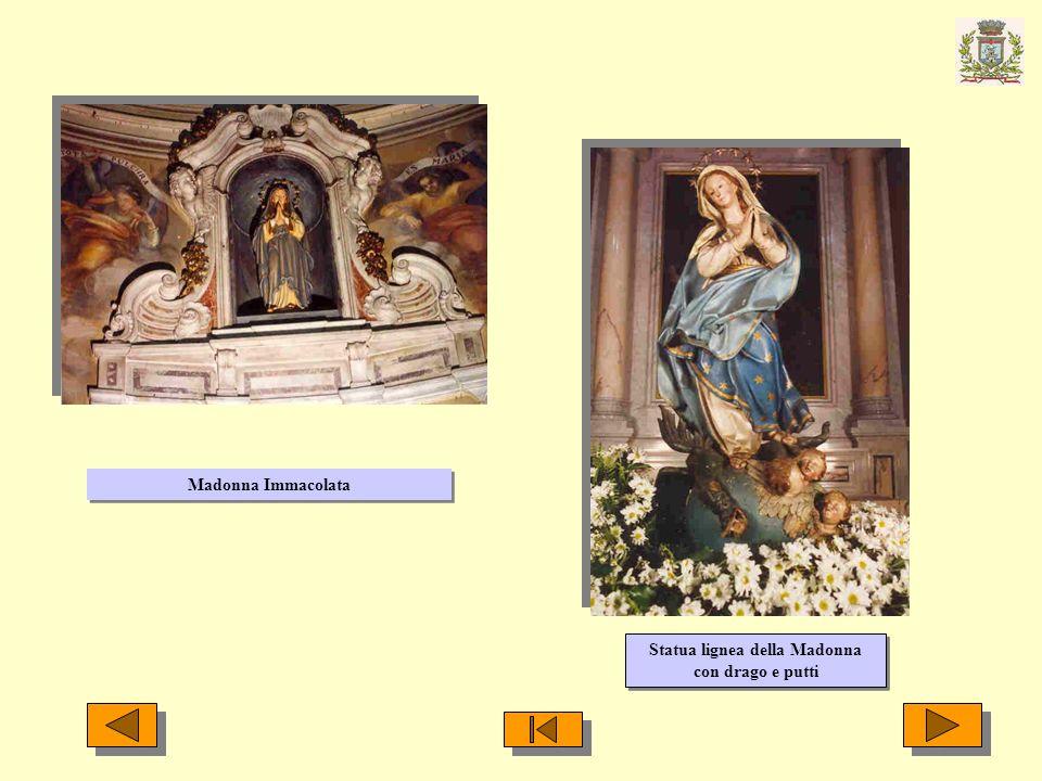 Statua lignea della Madonna con drago e putti