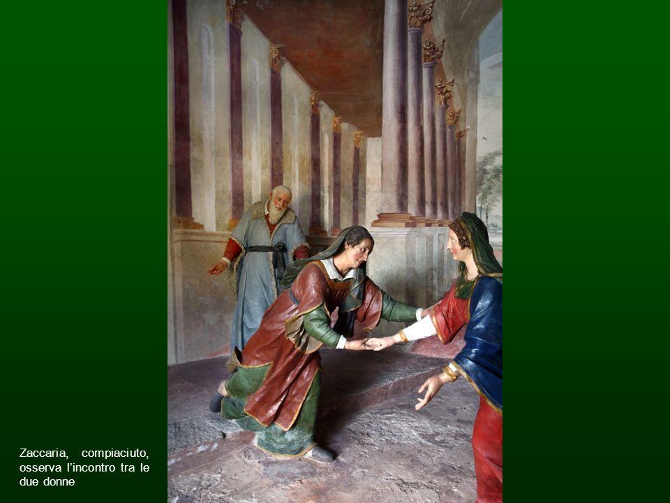 Zaccaria, compiaciuto, osserva l'incontro tra le due donne