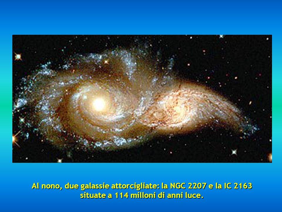 Al nono, due galassie attorcigliate: la NGC 2207 e la IC 2163 situate a 114 milloni di anni luce.