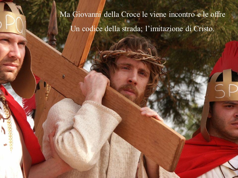 Ma Giovanni della Croce le viene incontro e le offre