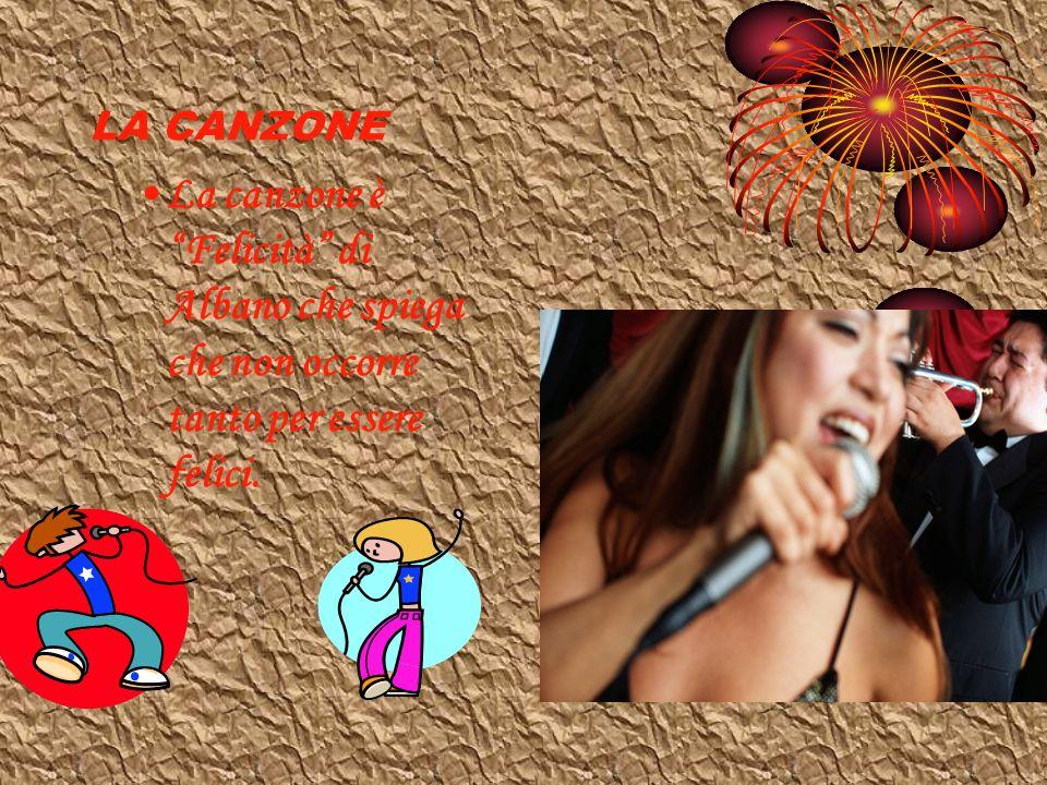 LA CANZONE La canzone è Felicità di Albano che spiega che non occorre tanto per essere felici.